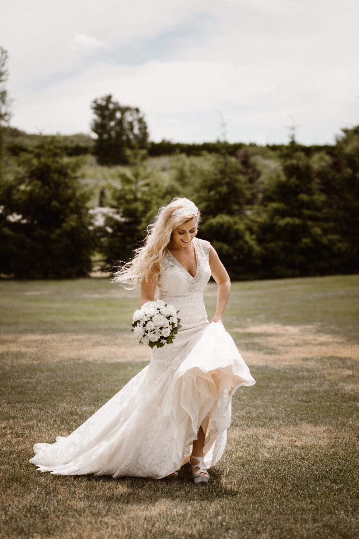 bride_bouquet_outdoors_trees_dress_outdoors_connecticut_rhode_island_massachusetts_new_england_wedding_photography_photographer_natural_laid_back_fun_adventure_light_engagement_session.jpg
