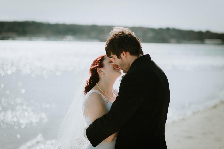 kiss_married_red_hair_april_spring_earrings_beach_water_kissadventure_outdoors_trees_dress_outdoors_connecticut_rhode_island_massachusetts_new_england_wedding_photography_photographer_natural_laid_back_fun_light_engagement_session.jpg