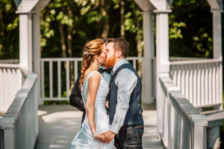 first-kiss-wedding-ceremony-you-may-kiss-the-bride-new-england-wedding-photographer-francis-farm.jpg
