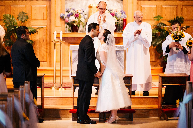 rhode-island-new-england-wedding-photographer-first-kiss-bride-groom-alter-adventure-outdoors-photographer.jpg