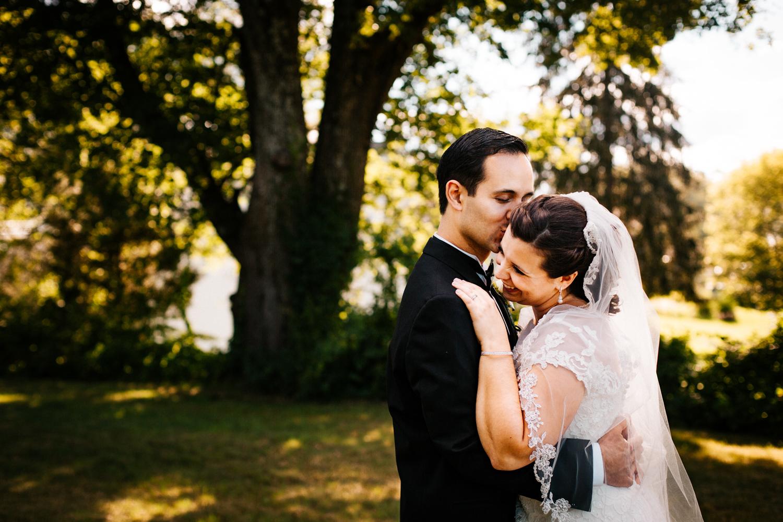 wedding-day-kiss-smiles-bride-groom-outdoorsy-new-england-ma-ct-rhode-island-wedding-photographer.jpg