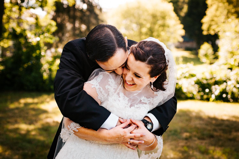 bride-and-groom-cuddles-love-boston-hartford-new-england-wedding-photography.jpg