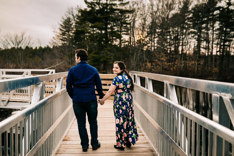 Couple walking down boardwalk in Massachusetts nature preserve