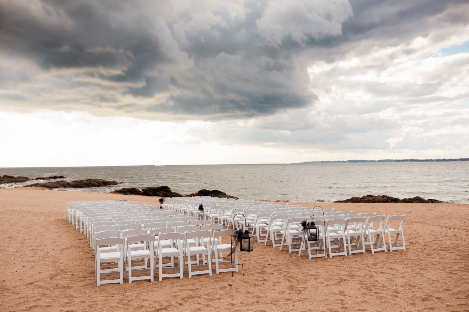 Beach wedding ceremony seating set up during storm