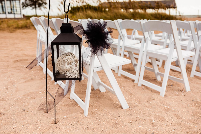 Skull decorations at halloween beach wedding
