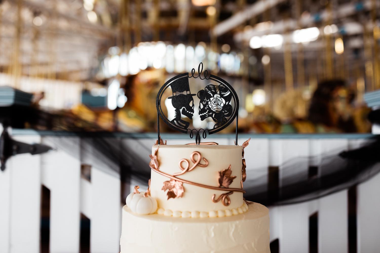 Skull and halloween themed wedding cake topper