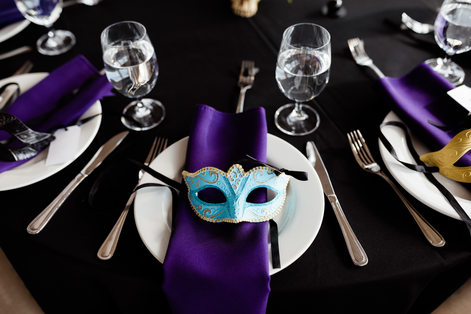 Masquerade themed wedding wedding table plate set up