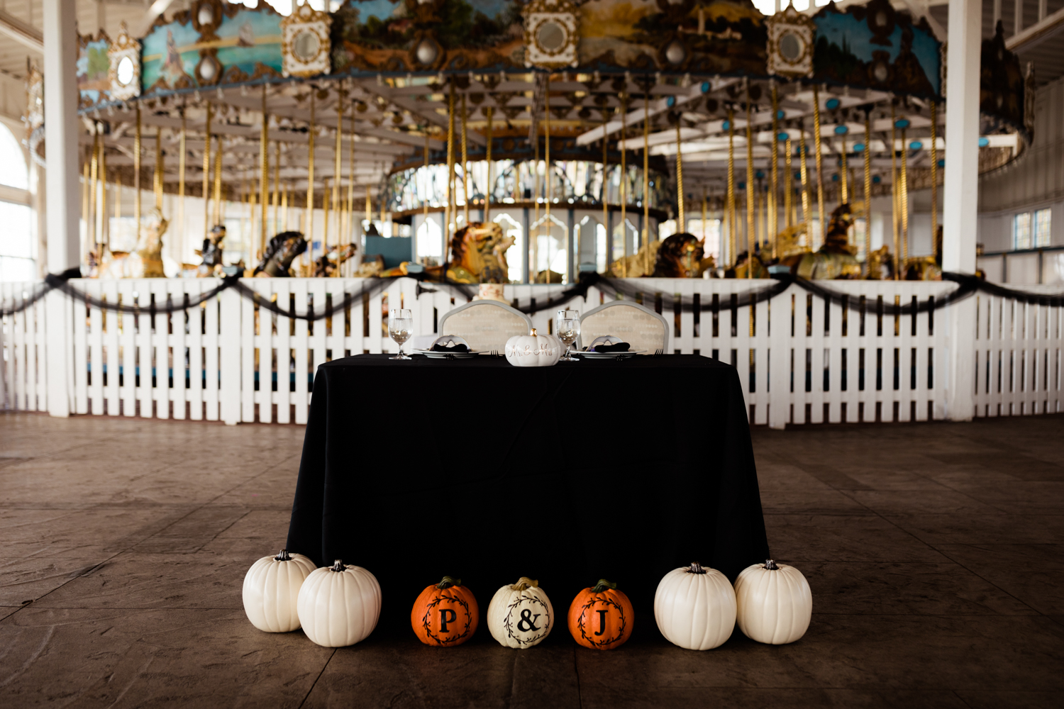 Halloween themed wedding sweetheart table with white pumpkins