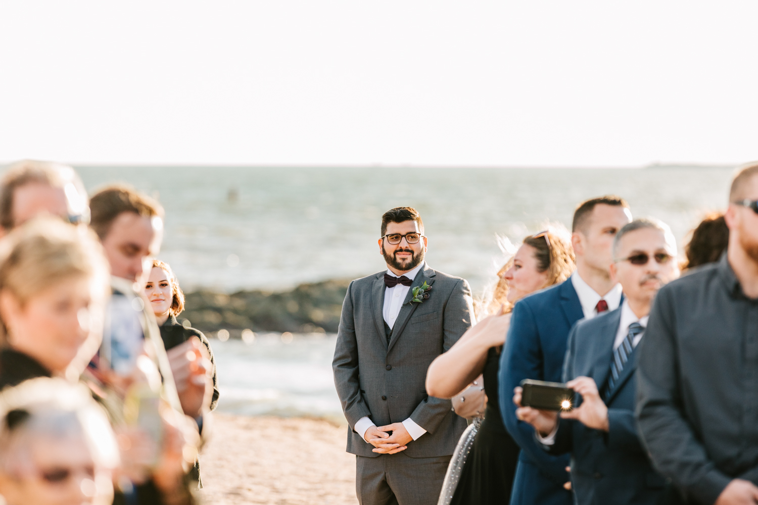 Groom seeing bride on wedding day during beach ceremony