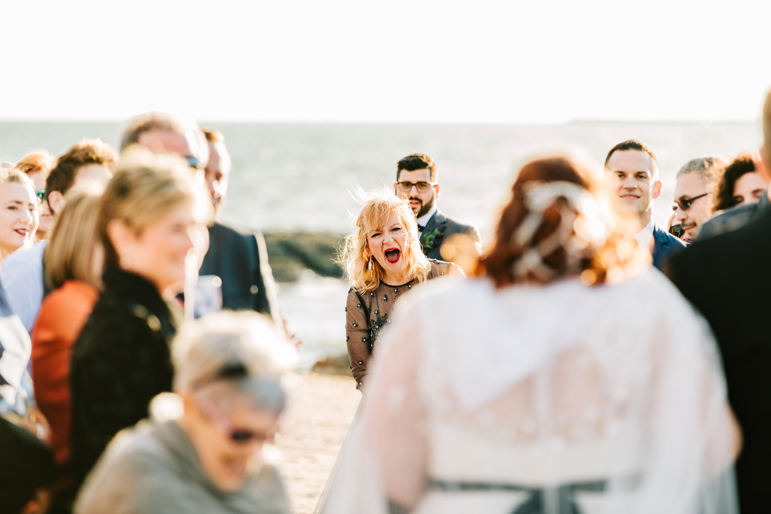 Bride's mother's reaction on beach wedding ceremony