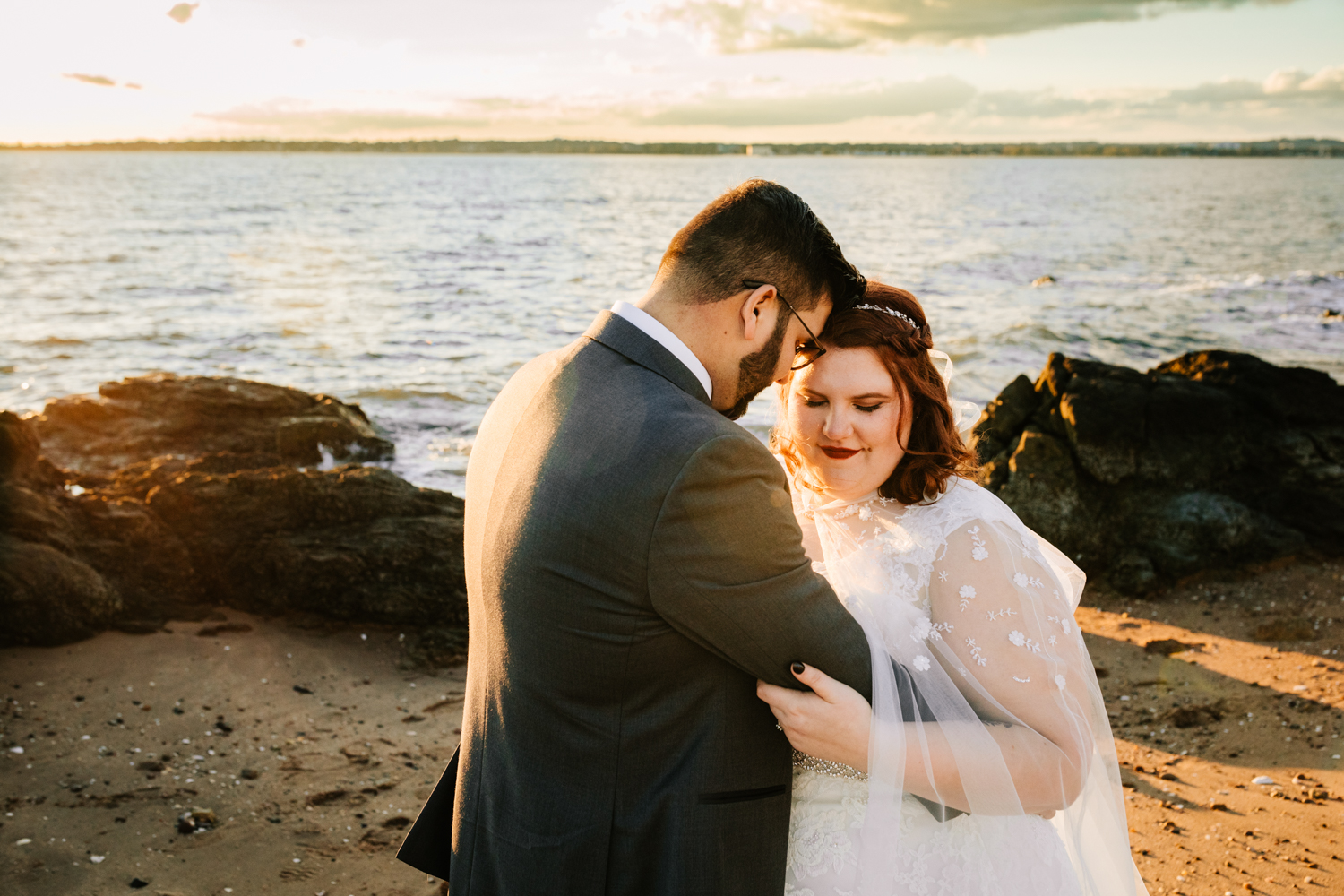 Red haired bride and groom on beach sunset wedding