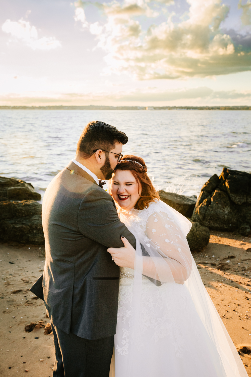 Bride and groom with ocean sunset background