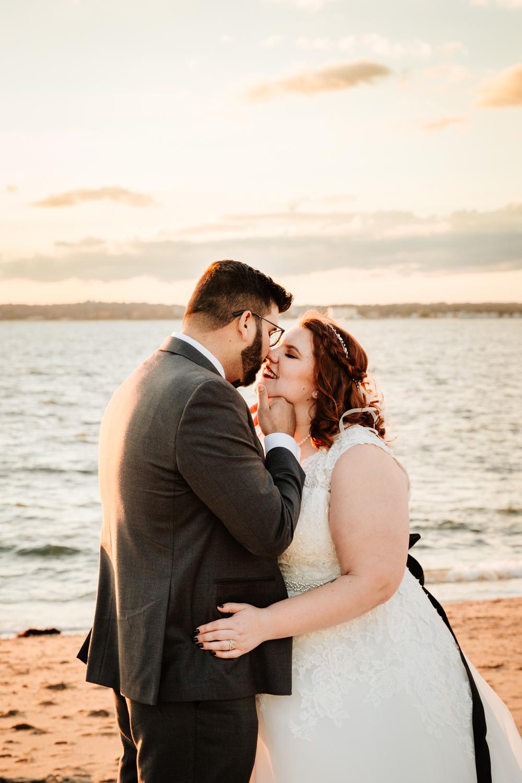 Bride and groom kiss on beach wedding