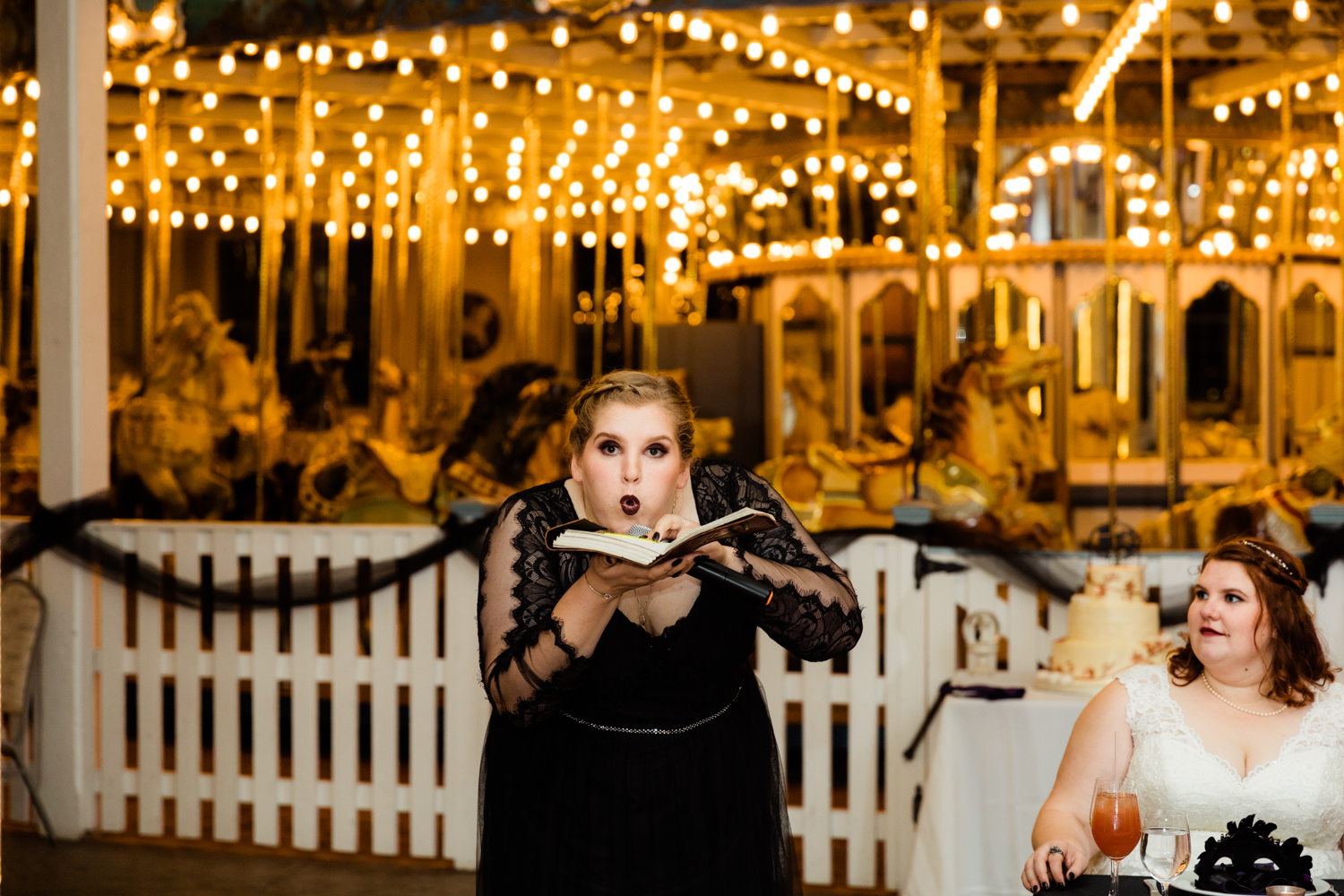 Maid of honor blowing on book for wedding day speech