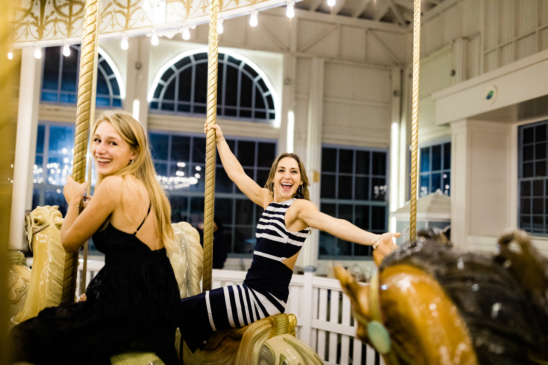 Wedding guests having fun on carousel