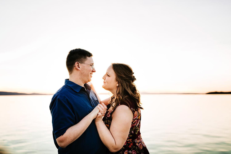 Couple dancing in mountain lake at sunset
