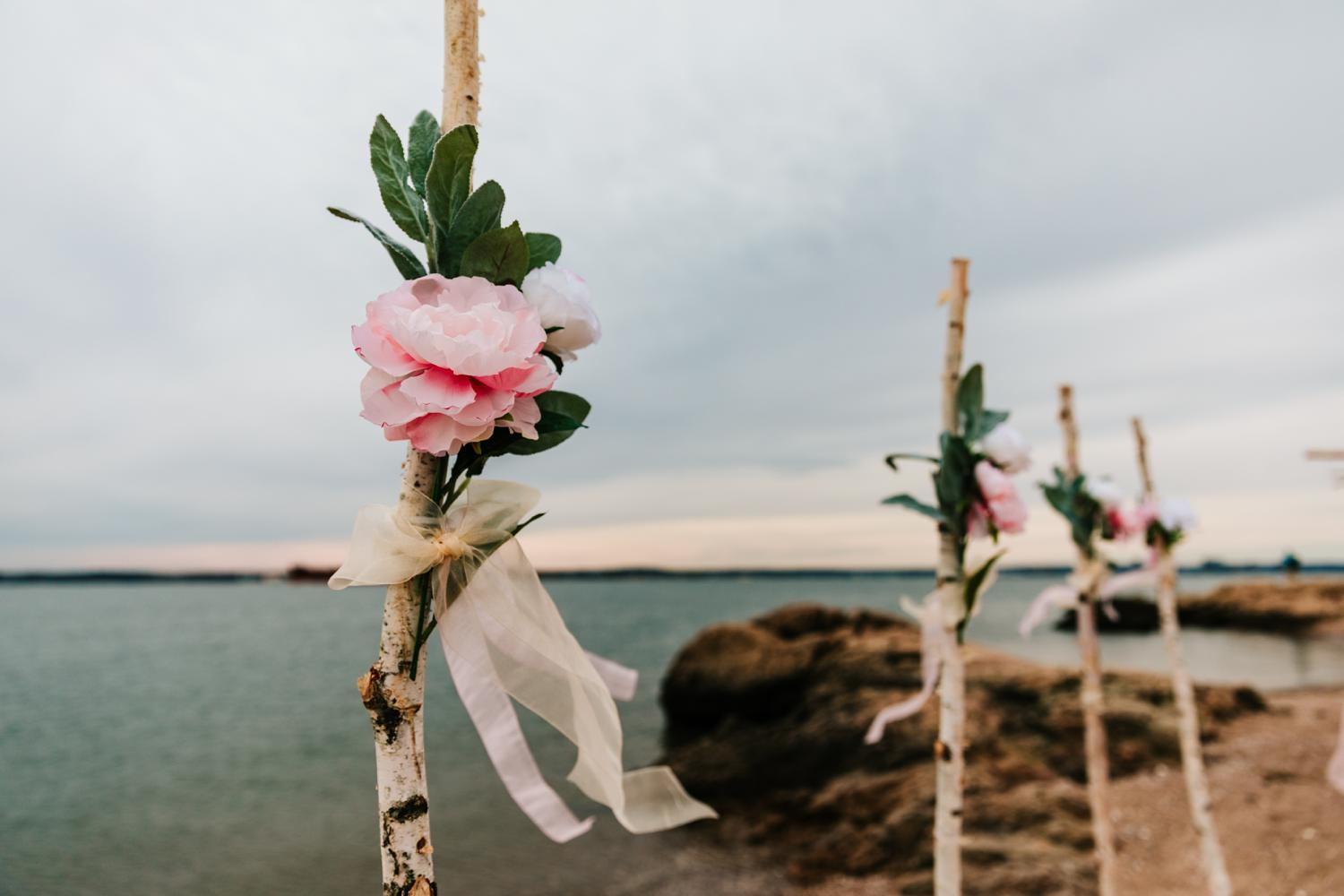 Pink roses for intimate beach wedding