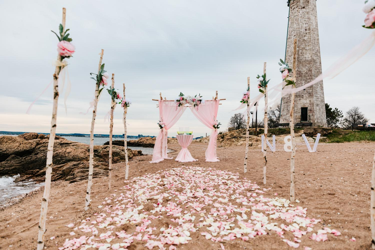 Beachy ceremony area for pink ocean wedding day