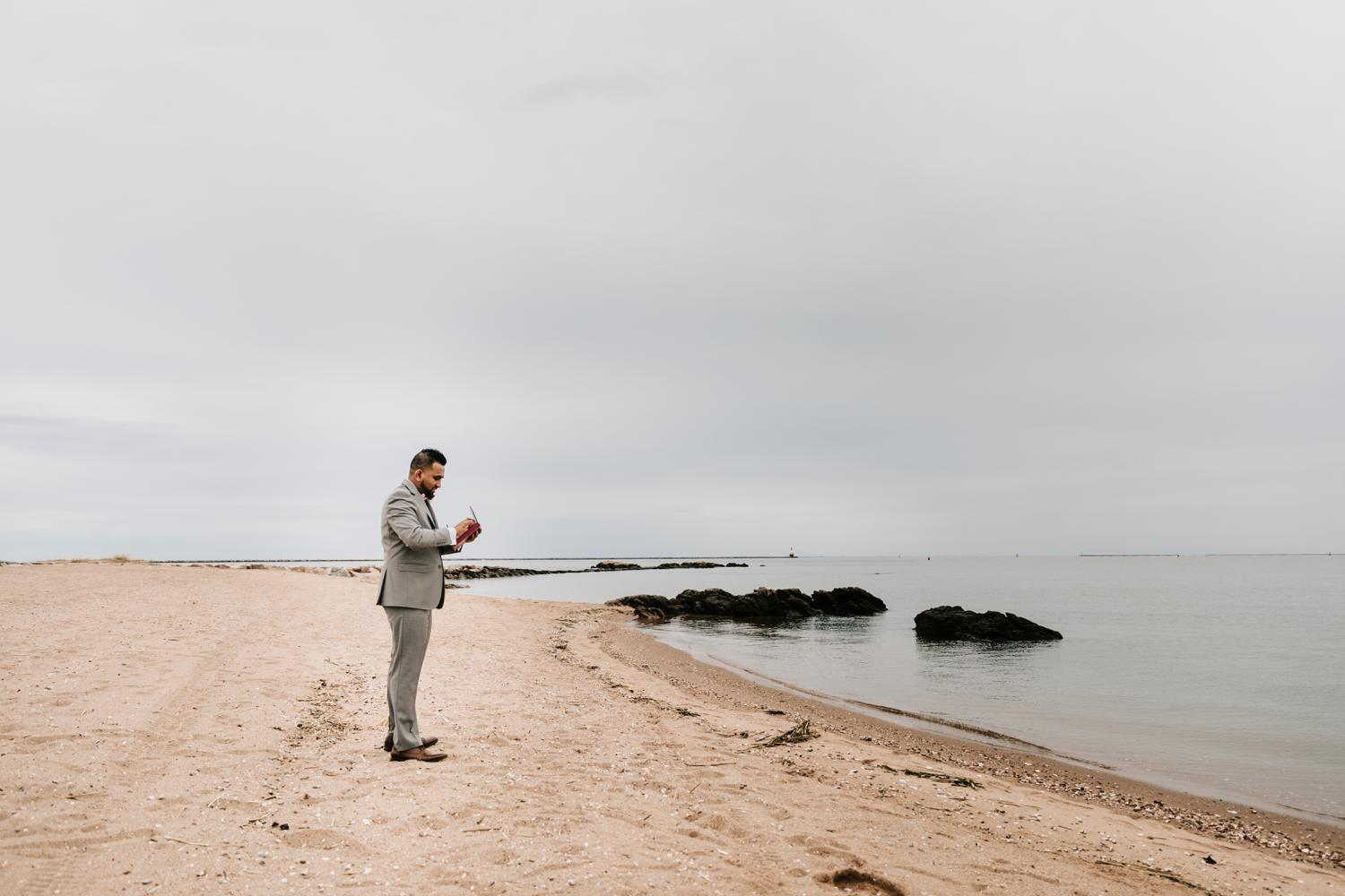 Groom waiting on beach for bride