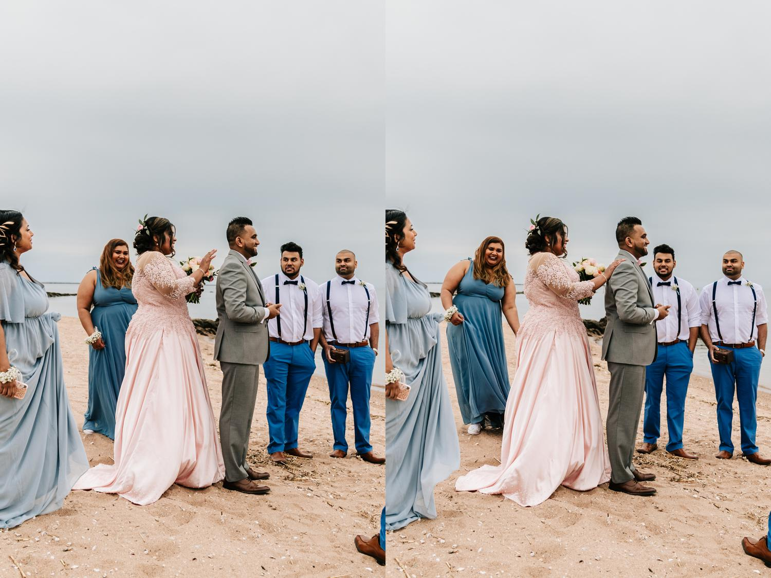 First look surrounded by bridal party on beach