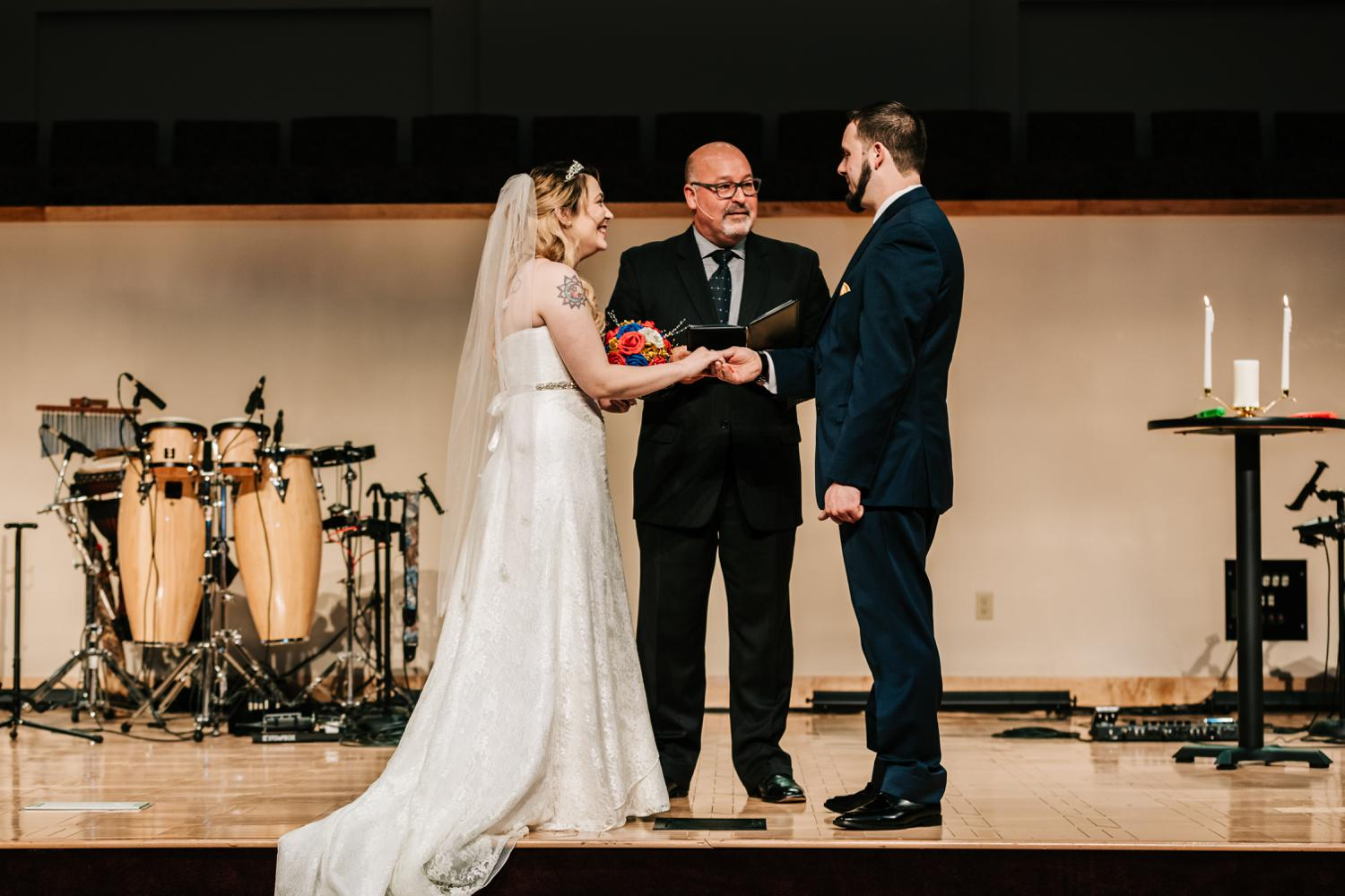 Bride and groom exchanging rings during wedding ceremony