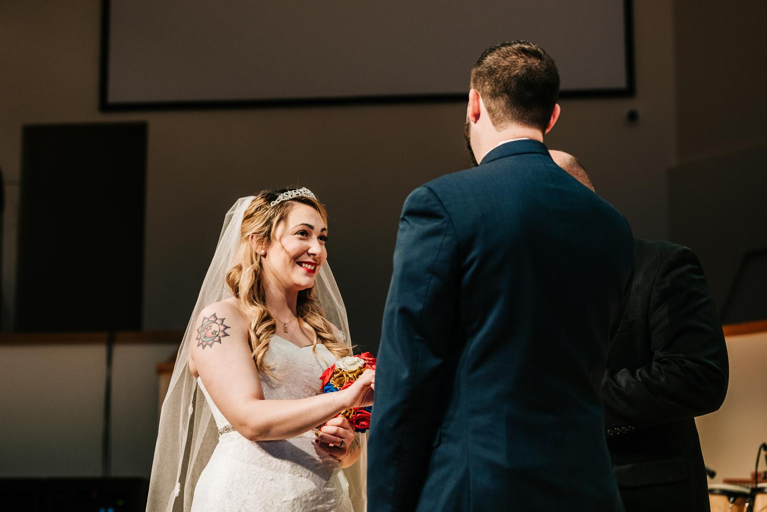 Bride smiling at groom during vows