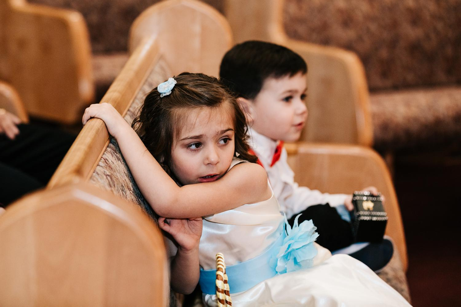 Bride's daughter looking on at wedding ceremony