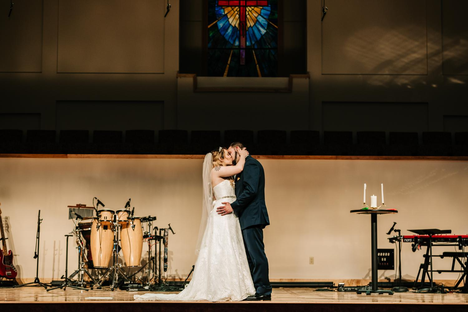 Tattoed bride' and groom's first kiss at altar