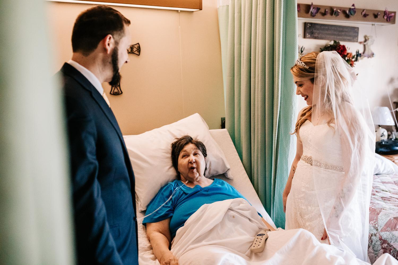 Bride and groom visiting grandmother in nursing home