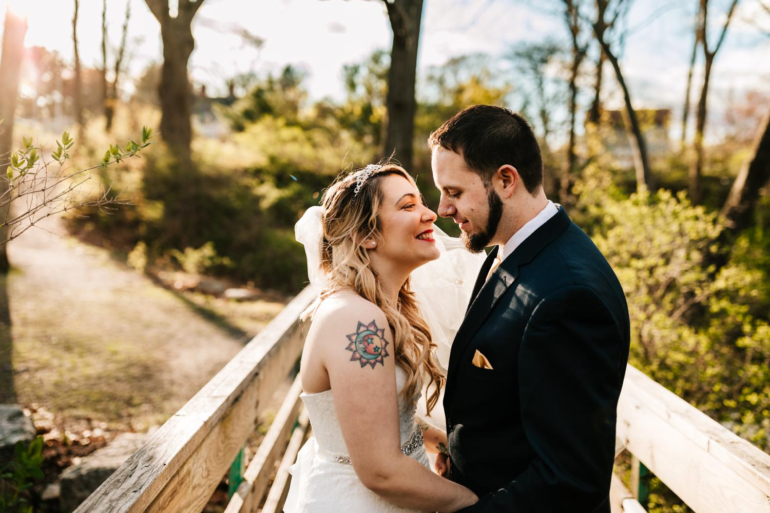 Bride and groom with tattoos before kissing