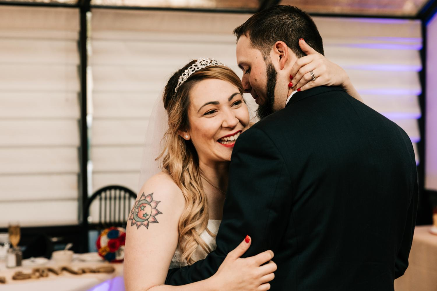 Tattooed bride and groom's first dance