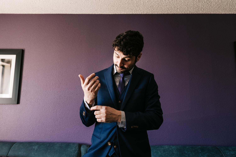 Groom in Navy Suit at El Paso Hotel