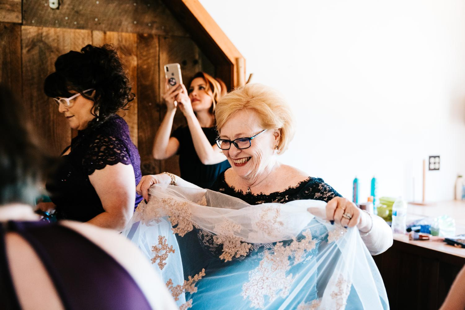 Bride's mother helping with wedding dress in El Paso