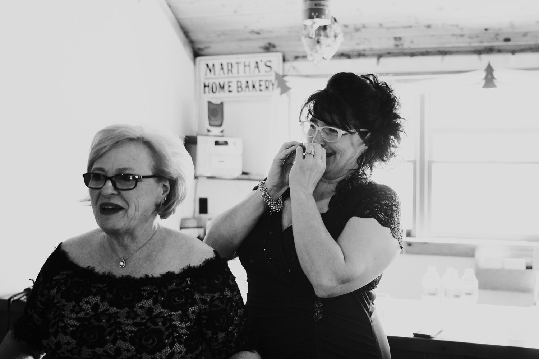 Bridesmaids react to bride wearing dress in El Paso