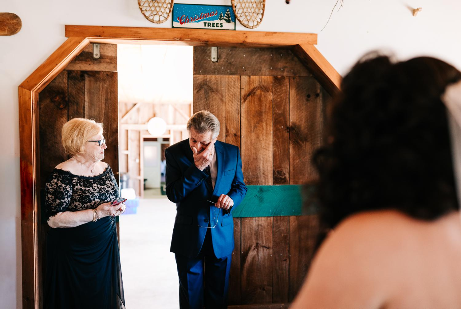 Father reacting to daughter as a bride for first look in Albuquerque
