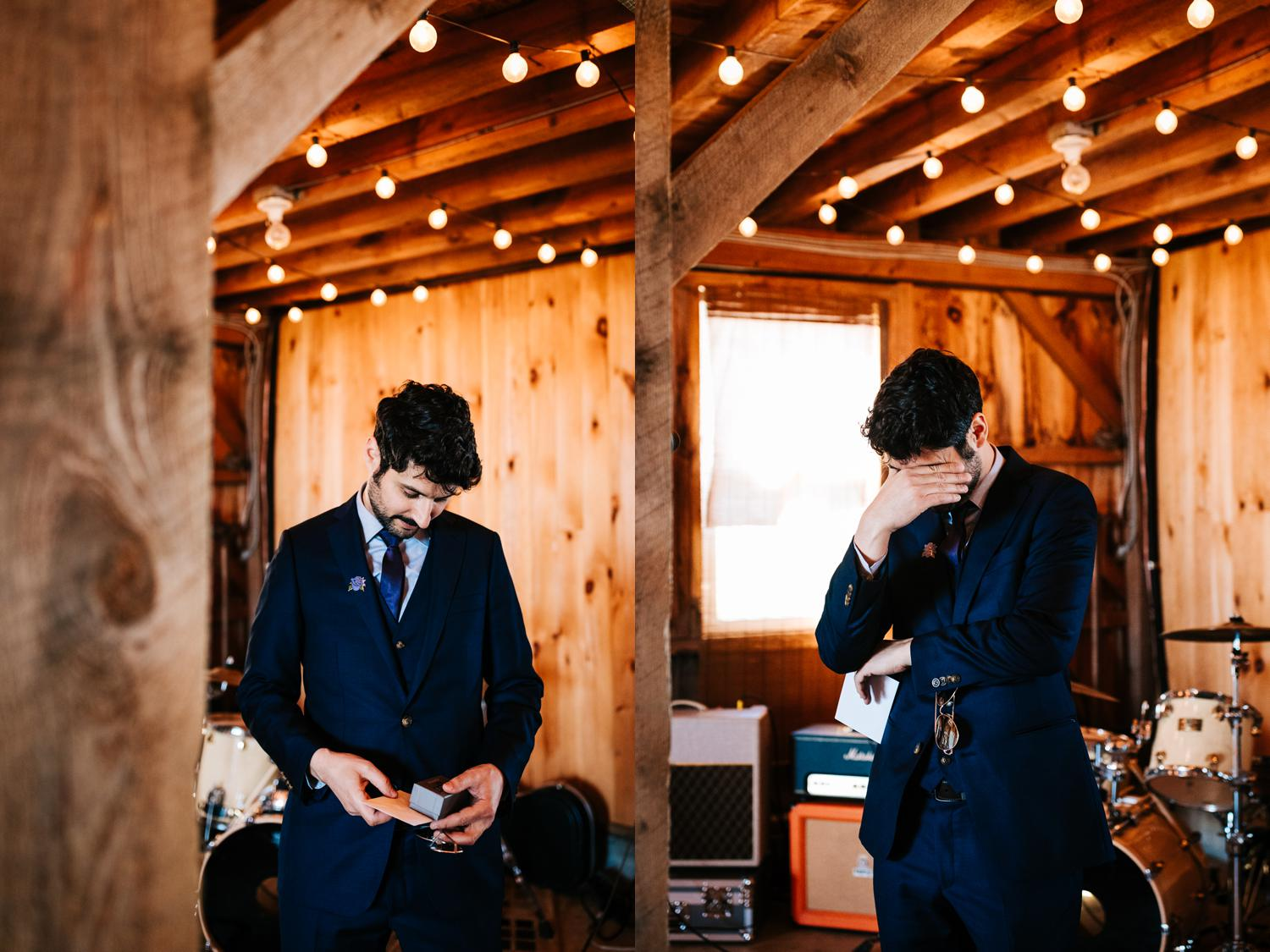 Groom reading note from bride in barn wedding in west Texas