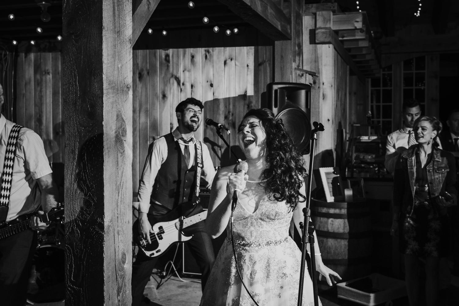 Bride and groom singing while band plays during El Paso wedding reception