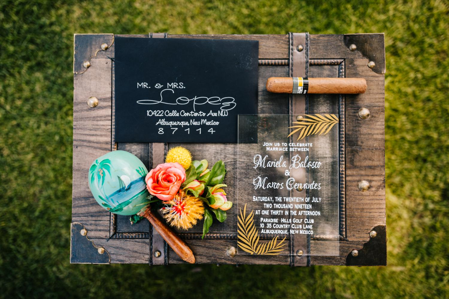Invitation wedding suite with glass invitations, black envelope, and vivid colors
