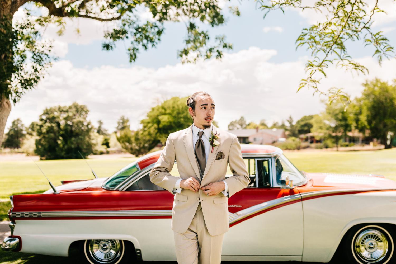 Tan groom attire for Havana themed New Mexico wedding