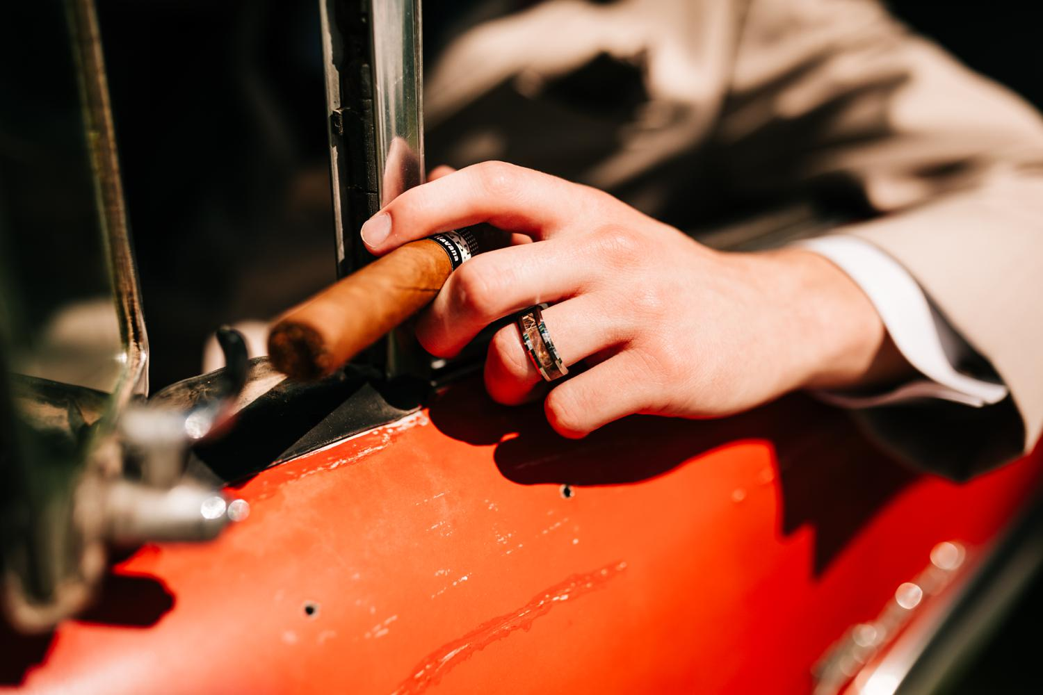 Groom with wedding ring and cuban cigar
