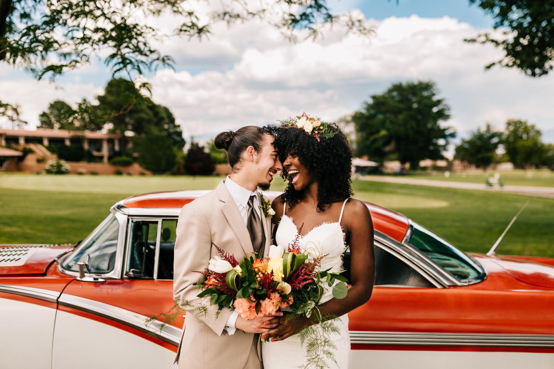Bride and groom happy in tropical themed wedding, Albuquerque