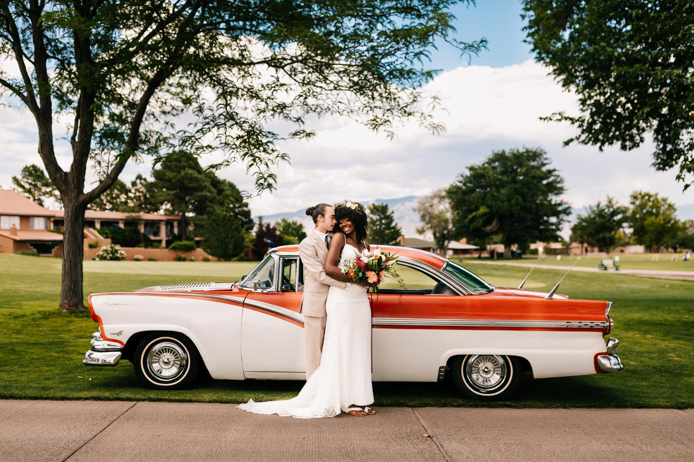 Bride and groom with vintage car in Albuquerque, New Mexico