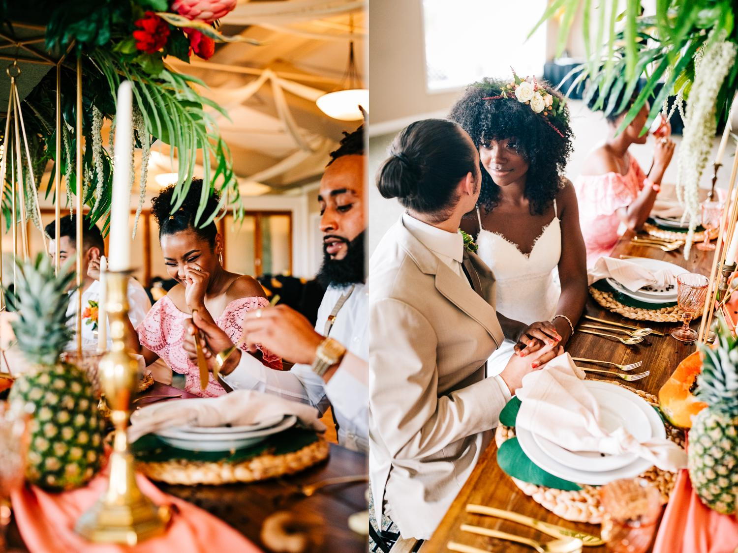 Guests laughing at tropical styled table at Albuquerque, New Mexico wedding