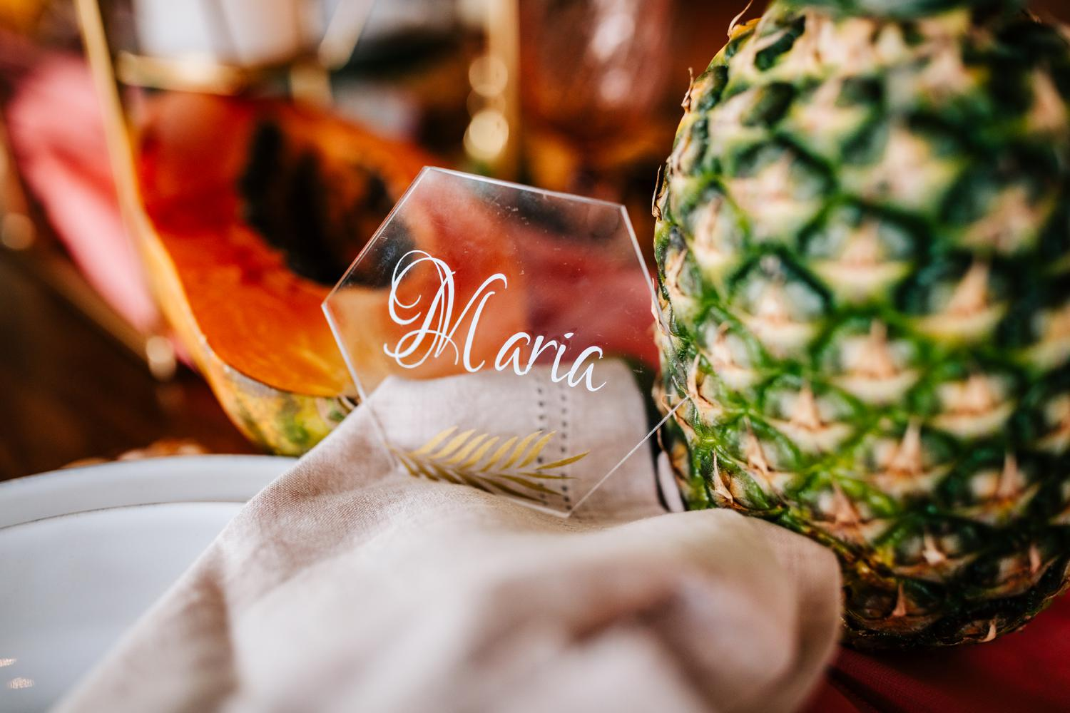 Glass and gold namecards for tropical New Mexico wedding