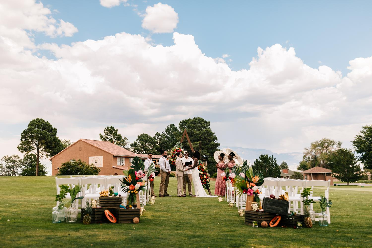 Tropical themed ceremony with arch in Albuquerque