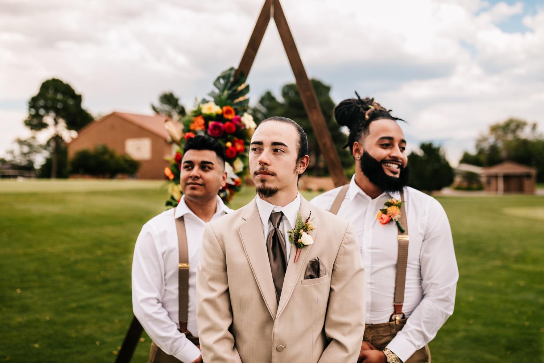 Groomsmen in suspenders wearing wedding attire ideas in New Mexico