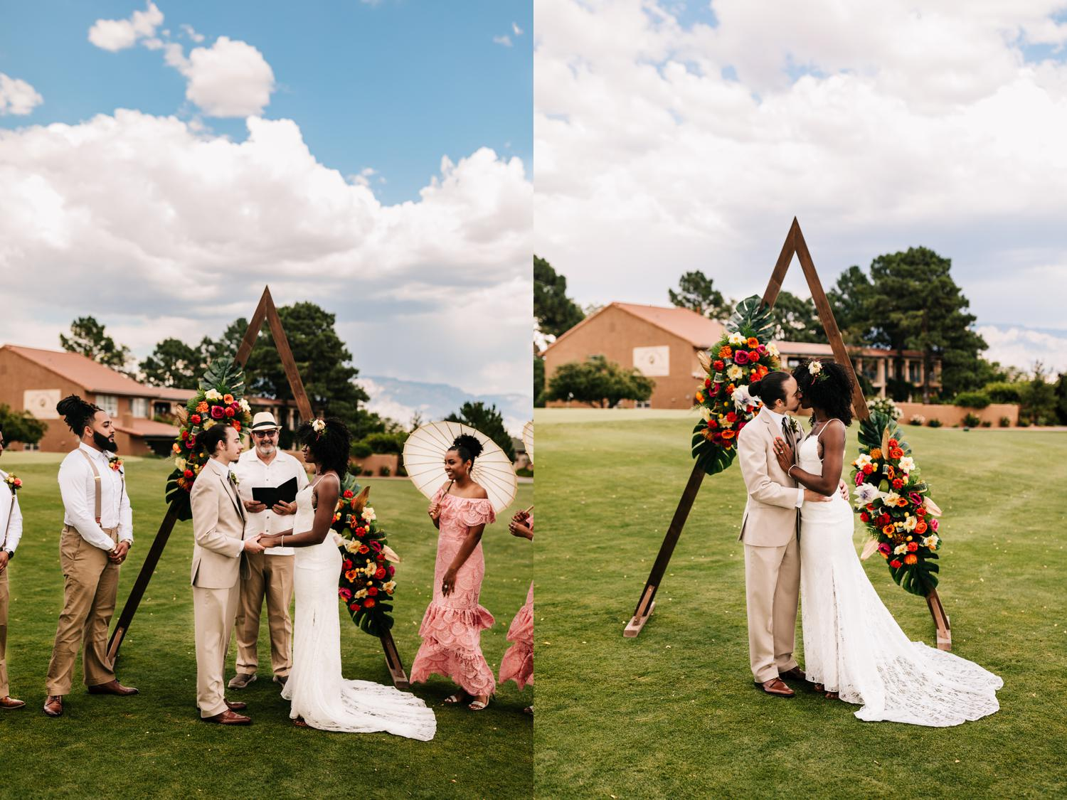 First kiss in tropical themed wedding, Albuquerque, New Mexico