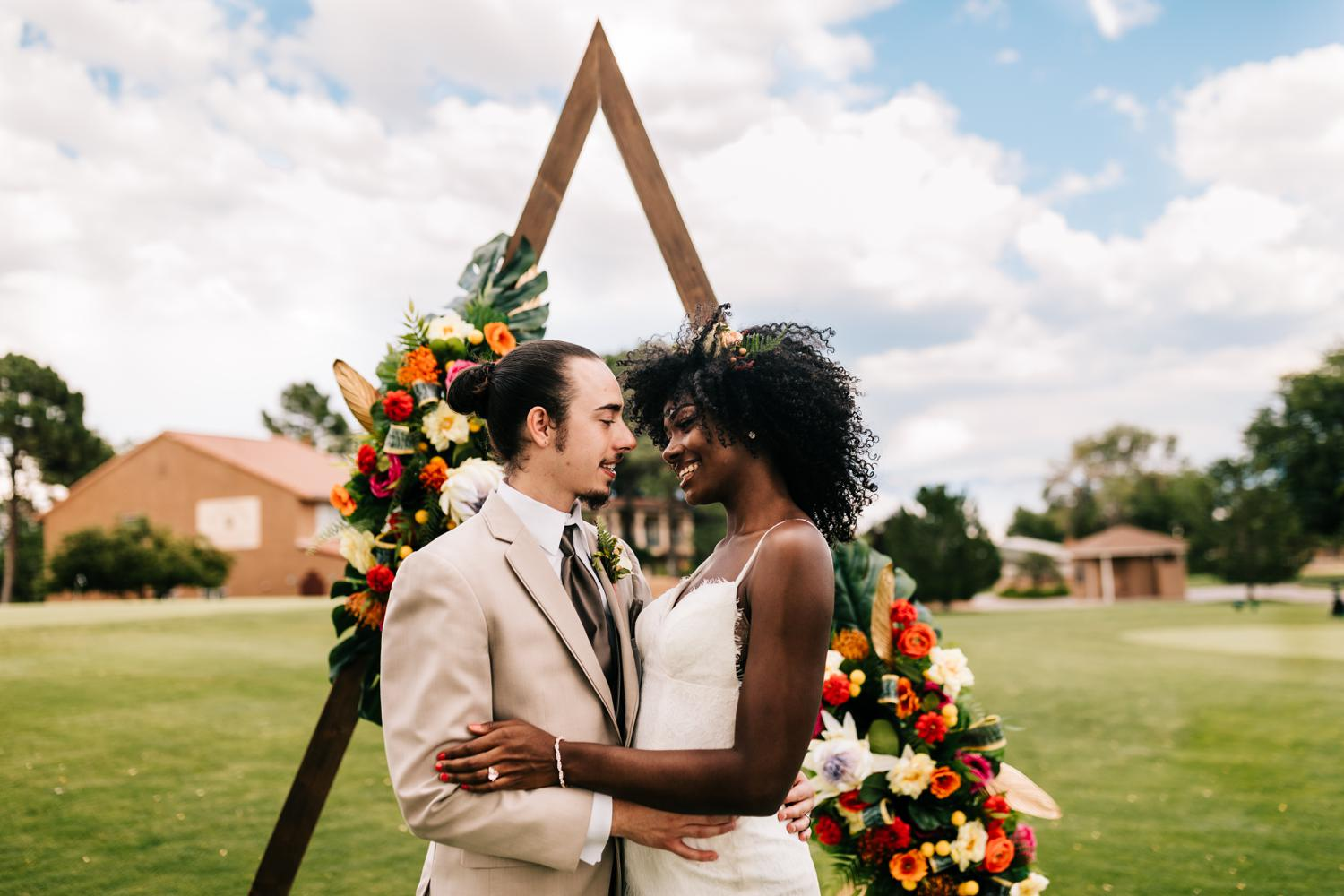 Bride and groom with arch for wedding ceremony in Albuquerque, New Mexico