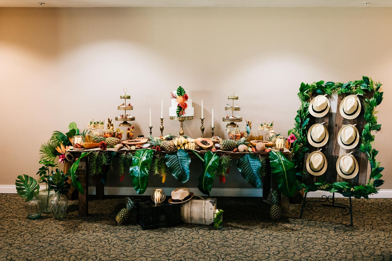 Banquet table with tropical themed cake, fruit, drinks for Havana styled shoot in Albuquerque, New Mexico