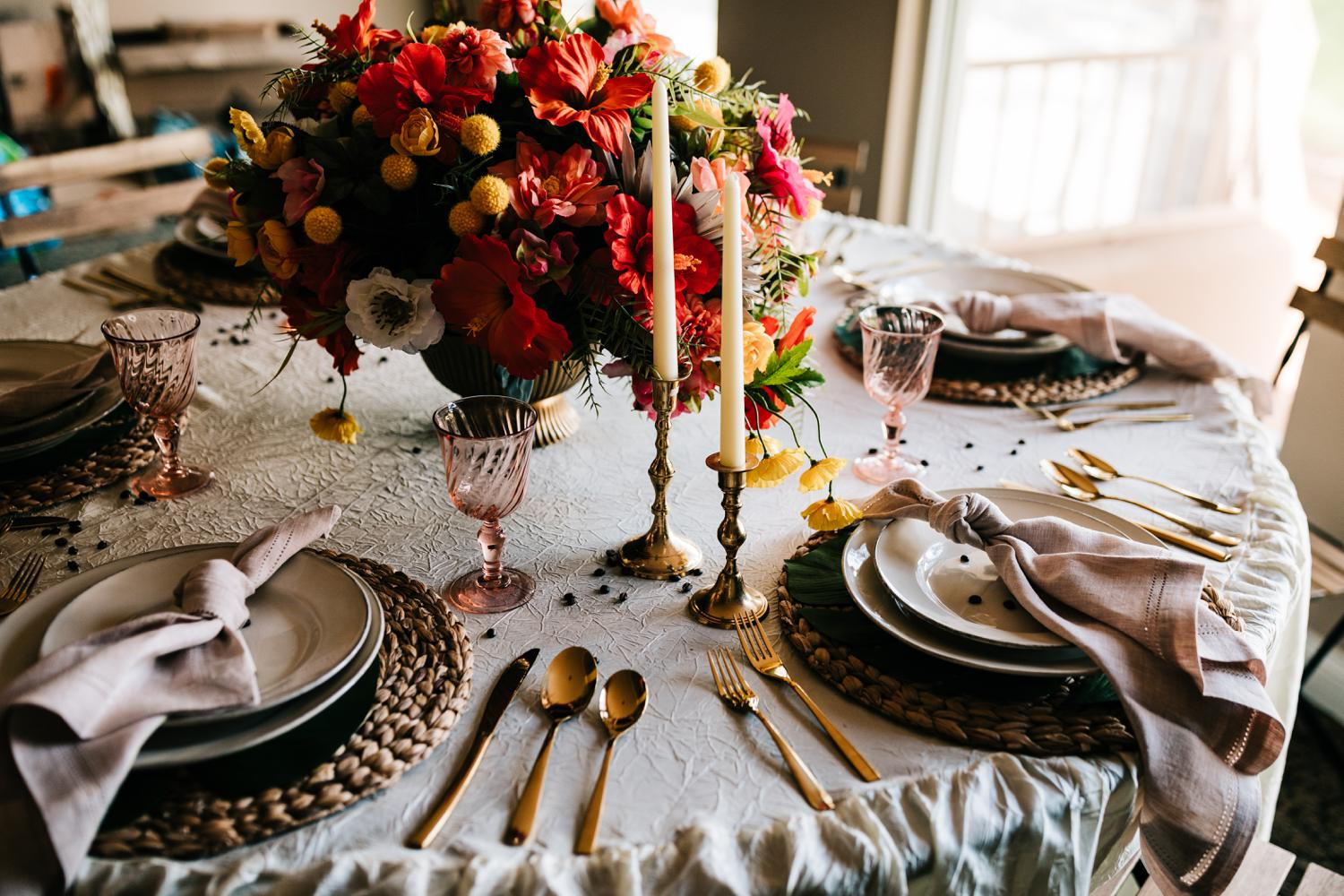 Colorful wedding accents with rose gold cutlery and bright flower centerpieces for Havana themed Albuquerque wedding